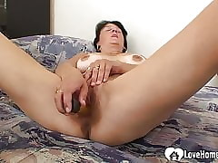 MILF moans after a long time carrying-on in the matter of a dildo