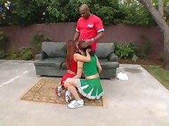 2 Young Cheerleaders together with a louring person